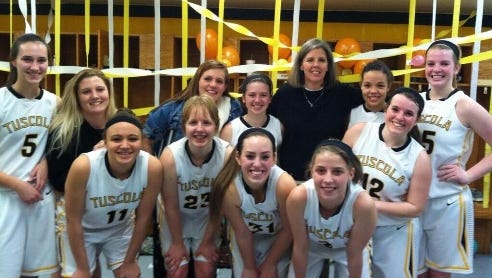 Tuscola girls basketball coach Ann Gardner won her 200th career game with last season's Mountaineers team.