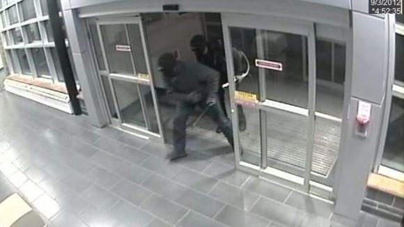 ATM torch robbers