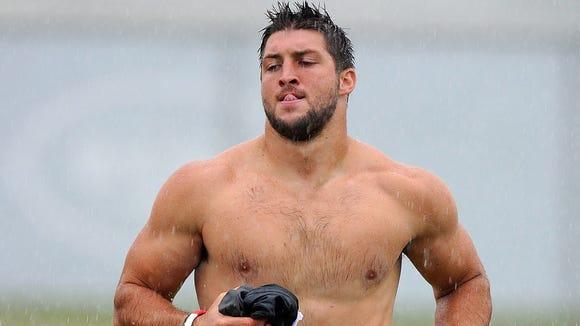 2012-1116-tim-tebow-shirtless