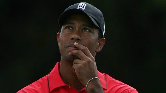 9 20 2012 Tiger Woods ponders