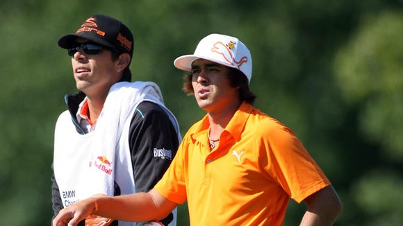 10 18 2012 Rickie Fowler with bag