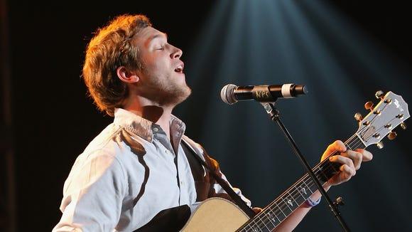 Phillip Phillips performs onstage in Syracuse, N.Y.