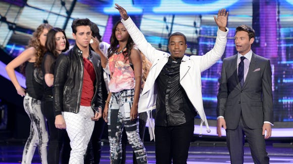 Burnell Taylor (Center) is eliminated on AMERICAN IDOL.