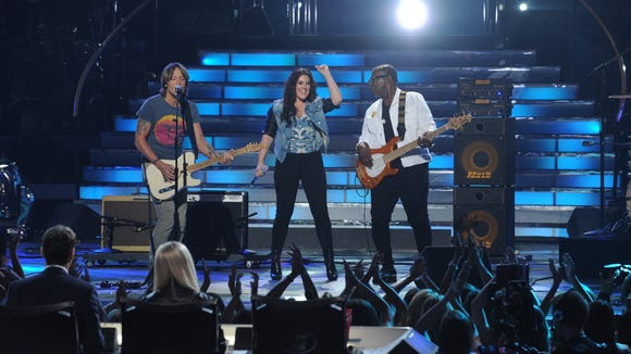 "Kree Harrison performs with ""American Idol"" Judges Keith Urban and Randy Jackson."