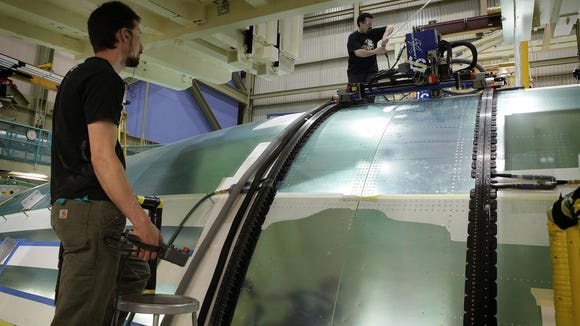 Painting Robots Speed Production Of Boeing 777s