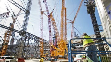 Cranes sit Monday inside the Atlanta Falcons new stadium currently under construction. Mercedes-Benz Stadium is scheduled to open in June 2017 and will host the Super Bowl in 2019.