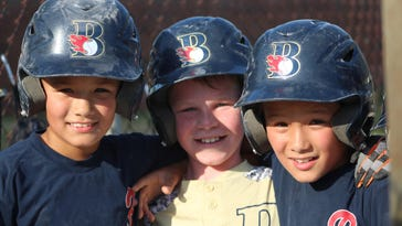 Birmingham Little League U10 baseball players (from left) Colton Kinnie, Louis Sullivan and Granden Kinnie are all smiles as they head to the state tournament in Midland.