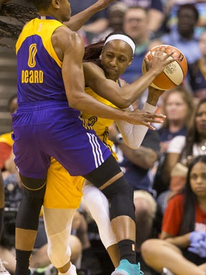 FILE -- Tiffany Mitchell of Indiana, is bottled up by Los Angeles' Alana Beard during game action in a 73-84 losing effort to the Los Angeles Sparks, Bankers Life Fieldhouse, Indianapolis, Saturday, June 24, 2017. Fever great Tamika Catchings was honored with a jersey retirement at halftime.