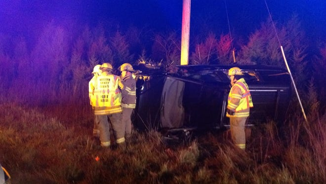 Firefighters respond to a fatal crash in Taney County on Tuesday December 16, 2014.