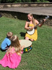 photos by allison wells/special to your hometown fun Rebecca Smith (left, above) will be teaching music to children in the SC Botanical Gardens Thursday mornings and evenings.