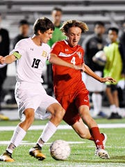 Susquehannock's Colin Kernan, right, battles for the