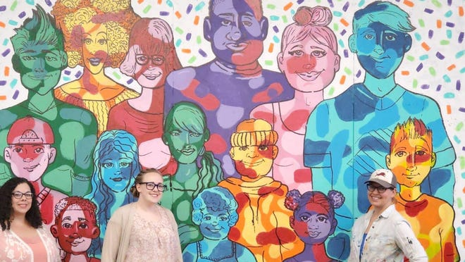 From left, Boys & Girls Club art director Christian Lewis, club CEO Katherine Palmer and Brownwood artist Amanda Coers are pictured in front of a commemorative mural Coers painted in the clubhouse.