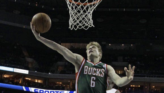 Milwaukee Bucks' Nate Wolters (6) drives past Charlotte Bobcats' Cody Zeller (40) during the first half of an NBA basketball game in Charlotte, N.C., Monday, Dec. 23, 2013.