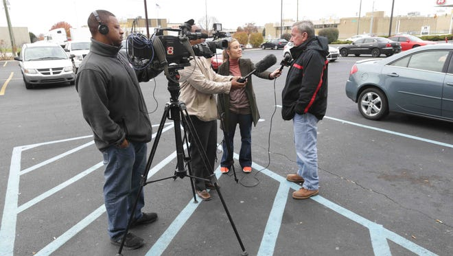Chuck Jones (right), president of United Steelworkers Local 1999, speaks with reporters about the latest Carrier Corp. announcement from a parking lot near the Carrier plant in Indianapolis, Wednesday, Nov. 30, 2016.
