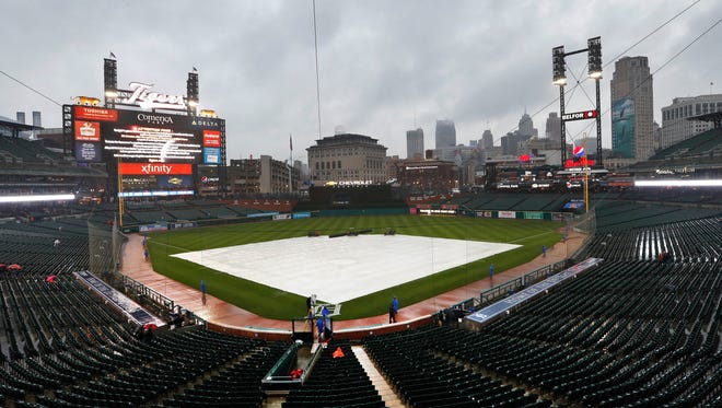 Rain falls on the field tarp at Comerica Park in Detroit, Friday, May 11, 2018. The baseball game between the Detroit Tigers and Seattle Mariners was postponed due to inclement weather.