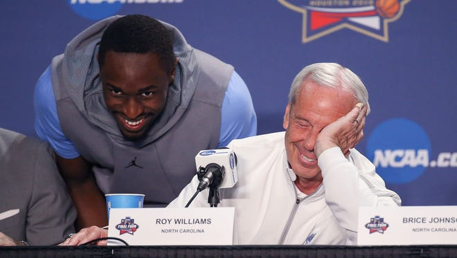 Forward Theo Pinson crases a news conference Sunday, bringing a laugh from his coach, Roy Williams.