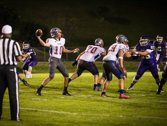 Junior Adam Garrison has time in the pocket to search