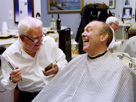 Sal the owner of Sal's Haircutters for Men retires