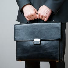Businessman with briefcase in hand.