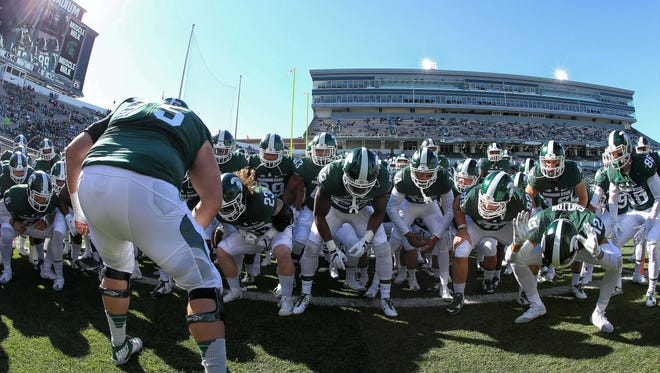 Michigan State Spartans take the field prior to a game against the Brigham Young Cougars at Spartan Stadium.