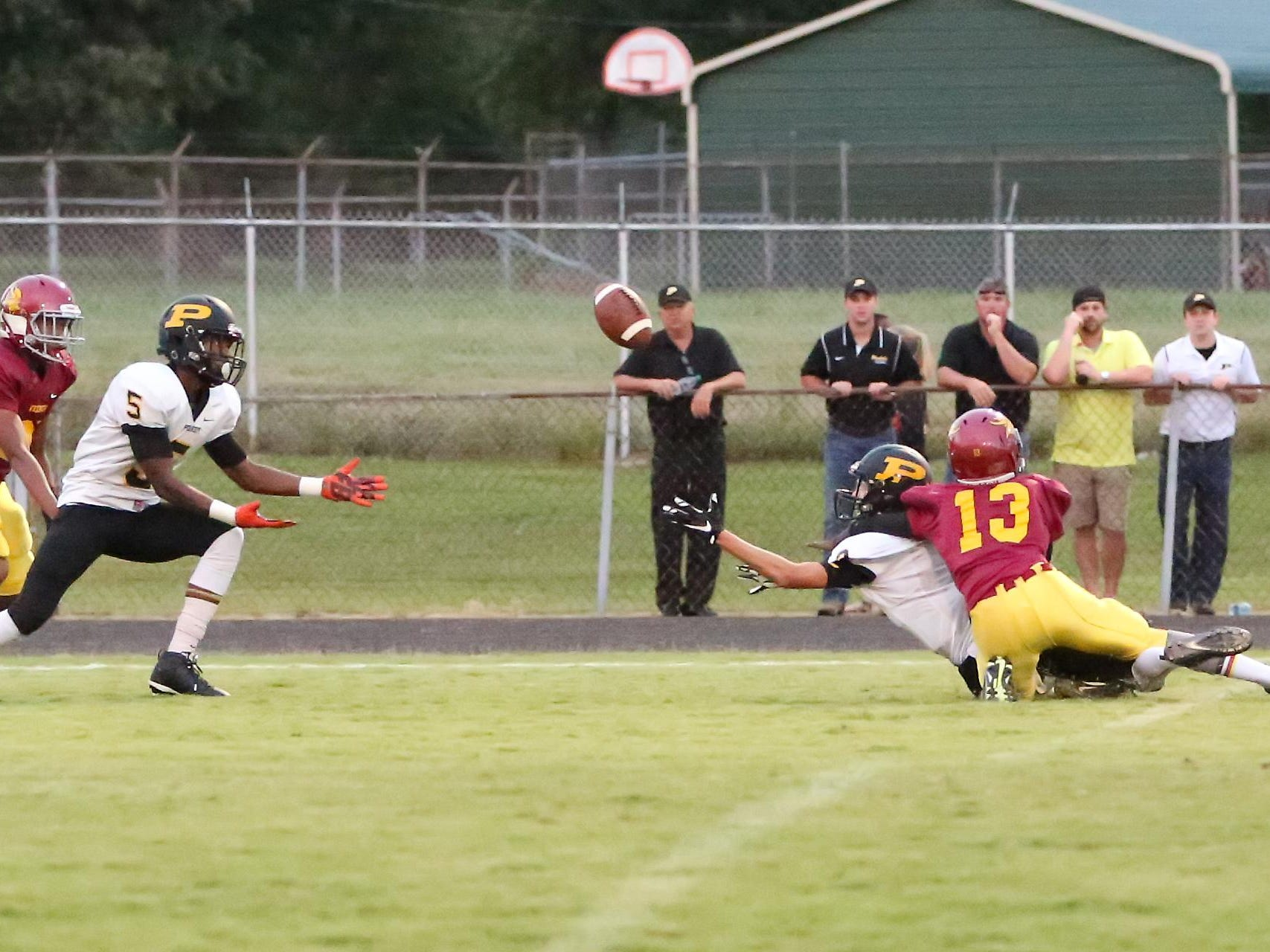 Trenton Peabody receiver Keyvon Goodwin catches the tipped throw for a touchdown Friday night against Humboldt.