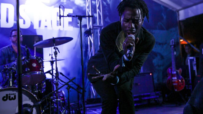 """Lead singer of Black Pumas Eric Burton performs """"Fire"""" at Banger's Sausage House and Beer Garden during SXSW on Wednesday, March 13, 2019."""