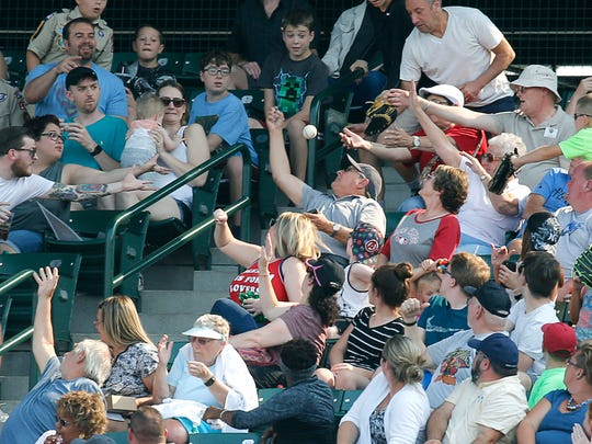Red Wings fans reach for a ball during a 2017 game against Pawtucket at Frontier Field.