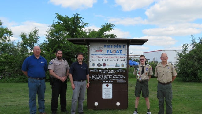 Pictured are, from left: John Redmond, City of Fond du Lac Park & Forestry superintendent, DNR Conservation Warden Supervisor Chris Shea, City of Fond du Lac Director of Public Works Jordan Skiff, Matthew Starks, and Tim Reid, Scoutmaster for Boy Scout Troop 777.