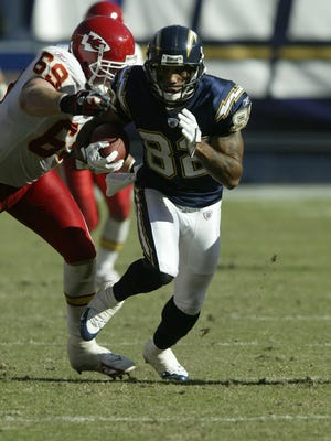 Former Patriots wide receiver Reche Caldwell (82) was reportedly shot and killed Saturday night in Tampa, Florida. In this file photo, with the San Diego Chargers, Caldwell (82) makes a play with the football against the Kansas City Chiefs during an NFL game, Sunday, Oct. 30 2005 in San Diego.