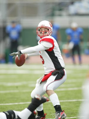 Former Eastland/Pearl City star Kam Kniss, shown passing against Concordia Wisconsin in the NCAA Division III playoffs, passed for more than 2,000 yards twice for E/PC and had over 10,000 yards passing for Norh Central.