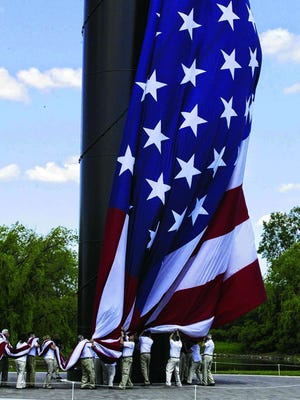 The flag is attached to Acuity's record-breaking flagpole during a dedication ceremony on Monday, June 16.