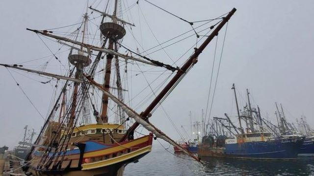 The Mayflower II is docked among fishing boats  at the State Pier on Tuesday morning, making an unexpected stop on its way to Plymouth.
