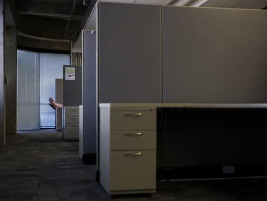A man sits in his cubicle while on a call at The Rocket