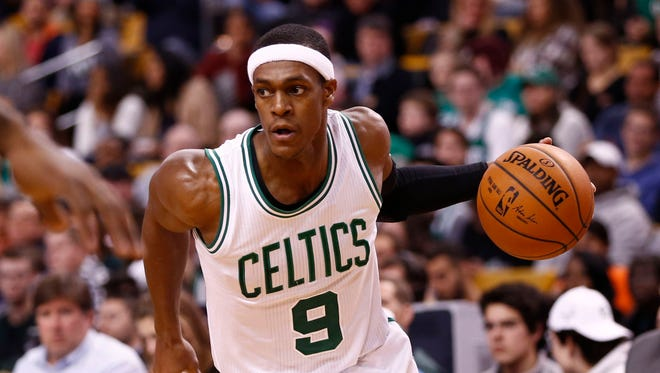Boston Celtics guard Rajon Rondo (9) drives to the hoop against the New York Knicks during the second half at TD Garden.