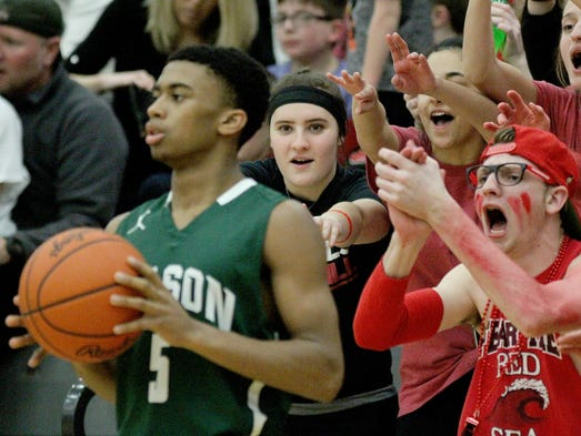 Mason's Carlos Lewis tries to inbound the ball in front