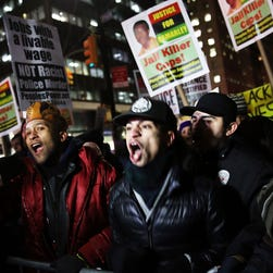 People demonstrate outside of City Hall in New York City.