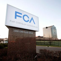 The Fiat Chrysler Automobiles Group sign is shown at the Chrysler Group headquarters in Auburn Hills, Michigan.