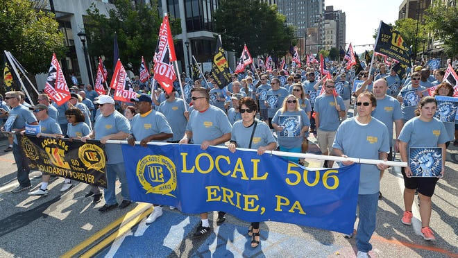 This is a 2017 file photo of thousands of spectators and union workers, including about 600 from UE Local 506, representing workers at GE Transportation, marching in the 2017 Labor Day parade in downtown Erie. The 2020 Labor Day parade has been canceled to slow the spread of COVID-19.