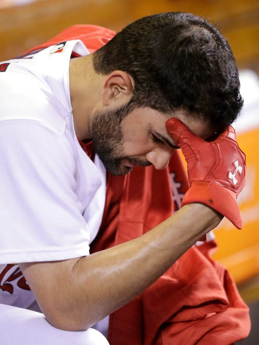 St. Louis Cardinals starting pitcher Jaime Garcia sits in the dugout after being pulled for a pinch-hitter during the fifth inning of a baseball game against the Colorado Rockies, Tuesday, May 17, 2016, in St. Louis. Garcia gave up three runs on five hits in five innings. (AP Photo/Tom Gannam)
