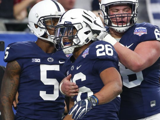 Connor McGovern (66) helped celebrate a Saquon Barkley touchdown in the Fiesta Bowl. McGovern, a three-year starter, declared that he will enter the NFL Draft early this spring.