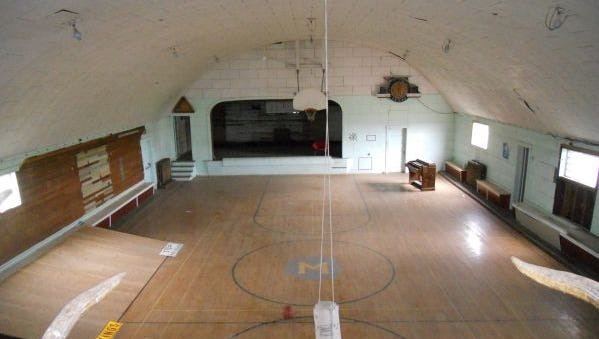 Inside the gym of the old Moccasin School. The school is crumbling, but the gym is for sale.