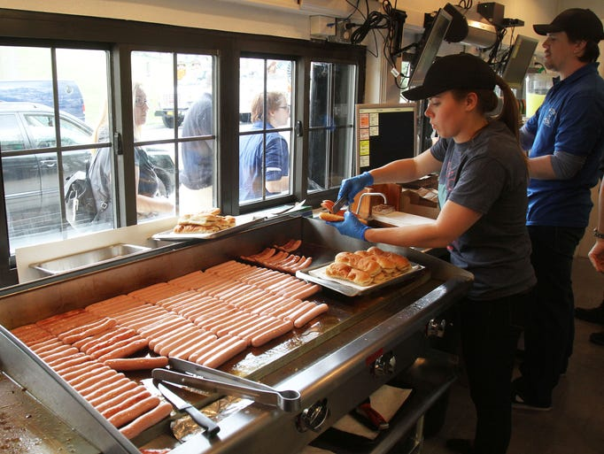 Katharine Warrington Woodward, great granddaughter of Walter's founder Walter Warrington, serves up hot dogs from behind the counter at Walter's in Mamaroneck May 2, 2014.