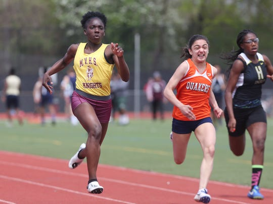 From left, Mt. Vernon's Jamika Hypolite on her way to winning the girl's 100 meter during the  Somers Lions Club Joe Wynne track and field invitational at Somers High School May 5, 2018.