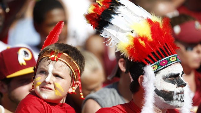 Washington Redskins fans dressed in Native American imagery.