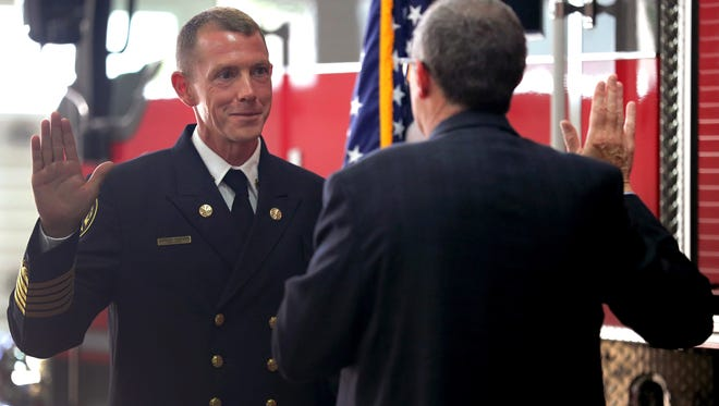 New Appleton Fire Chief Jeremy Hansen is sworn in by Appleton City Attorney James Walsh during a ceremony Monday at Fire Station 1 in Appleton.