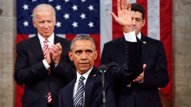 President Barack Obama waves at the conclusion of his State of the Union address to a joint session of Congress on Capitol Hill in Washington.