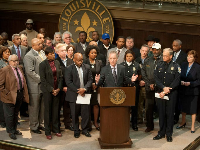 Mayor Greg Fischer speaks at a press conference (with his staff and members of his Safe and Healthy Neighborhooods Committee behind him) about the mob violence in downtown Louisville this past Saturday. March 24, 2014