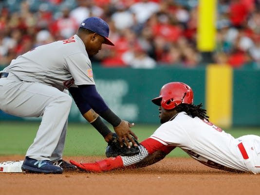 Los Angeles Angels center fielder Cameron Maybin is tagged out by Seattle Mariners shortstop Jean Segura on an attempted steal during the first inning of a baseball game in Anaheim, Calif., Saturday, July 1, 2017. (AP Photo/Chris Carlson)