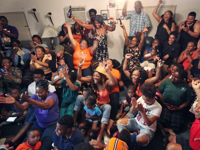 Friends and relatives of Sammy Watkins react as he is selected as the 4th pick overall in the 2014 NFL Draft on Thursday. Watkins was selected by the Buffalo Bills. Friends and family were watching the NFL Draft at Sammy Watkins Fort Myers home.