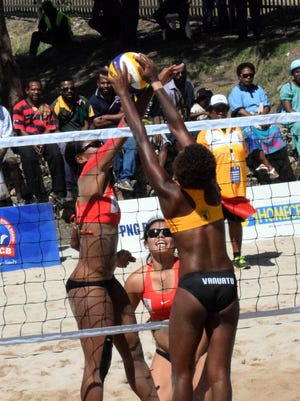 Guam women's national beach volleyball team member Tatiana Sablan fights for the ball during their match against Vanuatu Monday at the Sir John Guise beach courts at the Pacific Games in Port Moresby, Papua New Guinea in 2015.